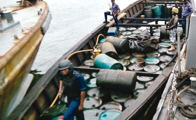 One of the boats seized by the Navy e1459760458606 - Navy nabs 11 suspected oil thieves