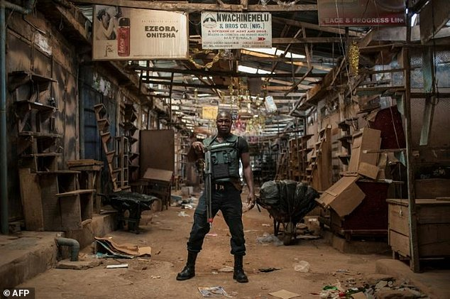 A security guard stands in the empty Ogbaru Market as shops and businesses shut down to mark the anniversary of the Biafra independence declaration