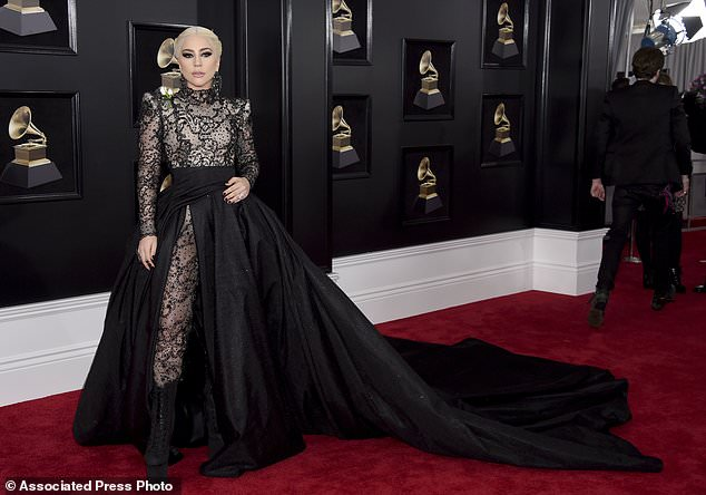 gaga - Gaga among stars wearing white roses on Grammys red carpet