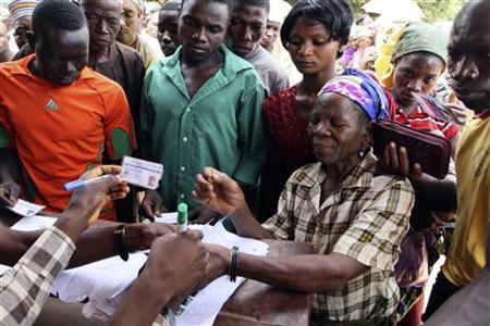 A woman's thumb is marked after verifying that she has a voter's card during parliamentary elections in Suleja, Niger state April 9, 2011.
