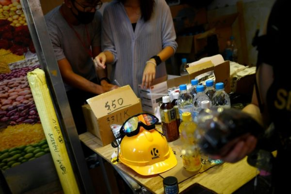 Gas Masks And Hard Hats At Hong Kong's Protest Pop Up Store